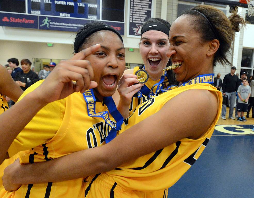 . From left, Bishop O\'Dowd High\'s Aisia Robertson (15), Alexandra Kalmbach (11) and Oderah Chidom (22) celebrate after their team won their Division III North Coast Section basketball game 77-48 against Miramonte High in Dublin, Calif., on Saturday, March 2, 2013. (Doug Duran/Staff)