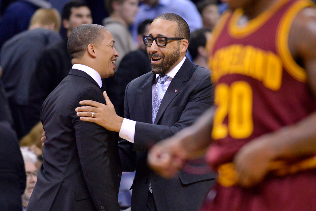 . Cleveland Cavaliers head coach Tyronn Lue, left, and Memphis Grizzlies head coach David Fizdale greet each other after an NBA basketball game Wednesday, Dec. 14, 2016, in Memphis, Tenn. (AP Photo/Brandon Dill)