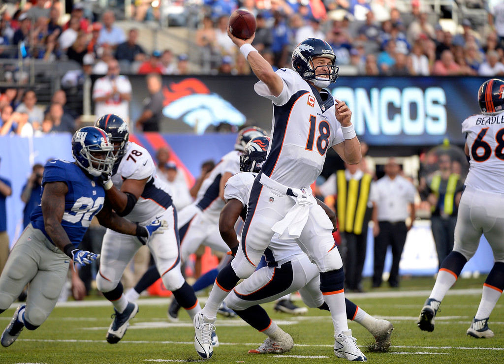 . Denver Broncos quarterback Peyton Manning (18) throws a pass against the New York Giants during the second quarter September 15, 2013 MetLife Stadium. (Photo by John Leyba/The Denver Post)