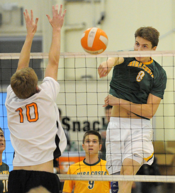 . 05-15-2013-( Daily Breeze Staff Photo by Sean Hiller) Huntington Beach swept Mira Costa in Wednesday\'s  boys volleyball CIF Southern Section Division I semifinal at Huntington Beach High School. Costa\'s Ryan Kaseff (8) battles HB\'s Andrew Tenbrink(10).
