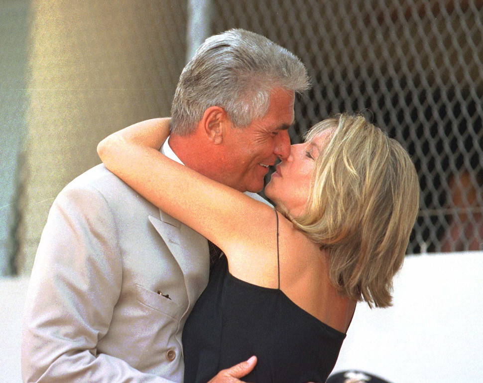. US singer and actress Barbra Streisand gives her husband actor James Brolin a kiss during his Hollywood star installation on the Walk of Fame in Hollywood, California, 27 August.  (FREDERICK M. BROWN/AFP/Getty Images)