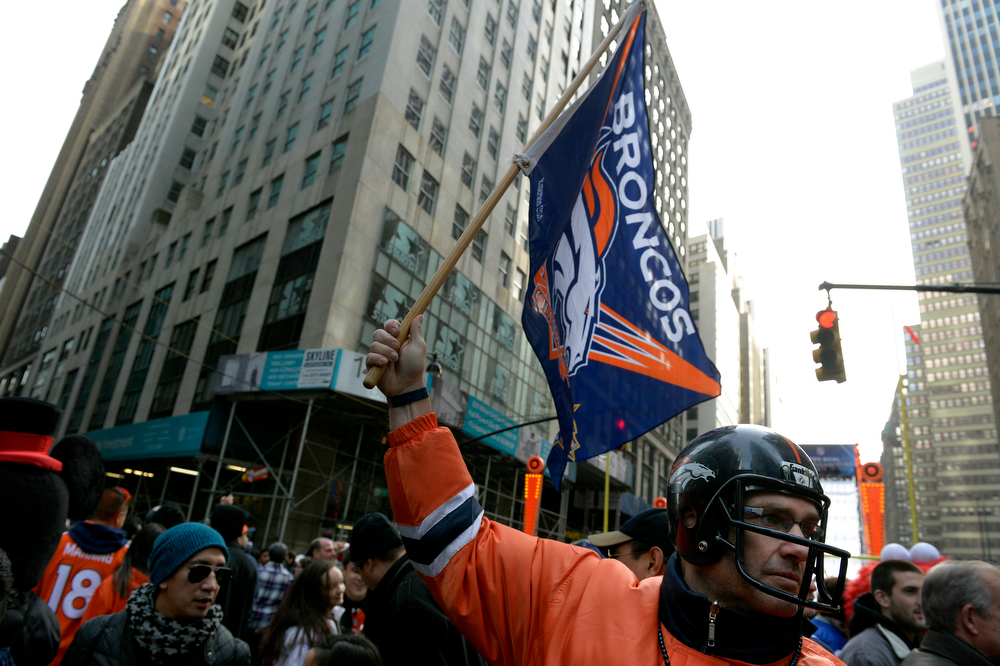 . Brian Carey, of Brick, NJ, wears his sons Broncos helmet while visiting Super Bowl Boulevard in New York, NY February 02, 2014. The NFL has transformed 13 blocks of Broadway into a center for Super Bowl activity before Sundays Super Bowl between the Denver Broncos and Seattle Seahawks. He said the helmet is 13 years old and predicted a 36-24 Broncos victory. (Photo By Craig F. Walker / The Denver Post)