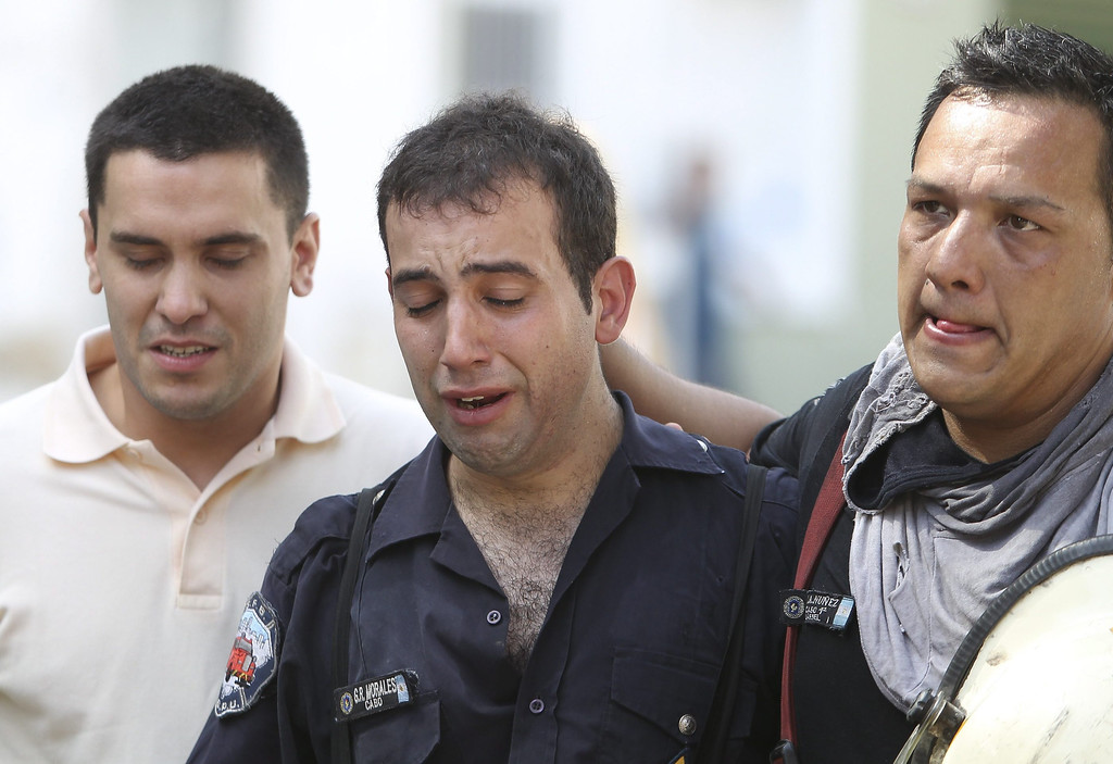 . An Argentinian firefighter cries after the death of nine members of the emergency team during a fire at a warehouse located in southern Buenos Aires, Argentina, 05 February 2014. According to Buenos Aires\' security secretary Sergio Berni, at least nine people died and seven were injured in the fire. Argentinian President Cristina Fernandez declared two days of mourning for the victims.  EPA/DAVID FERNANDEZ
