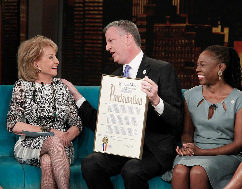 ". This image released by ABC shows host Barbara Walters, left, with New York City Mayor Bill de Blasio and his wife Chirlane McCray on ABC\'s ""The View,\"" Monday, April 21, 2014 in New York. De Blasio is proclaiming May 16 as \'Barbara Walters Day\' in New York City.  Walters is retiring that day after a storied television reporting career that has spanned five decades.  (AP Photo/ABC, Lou Rocco)"