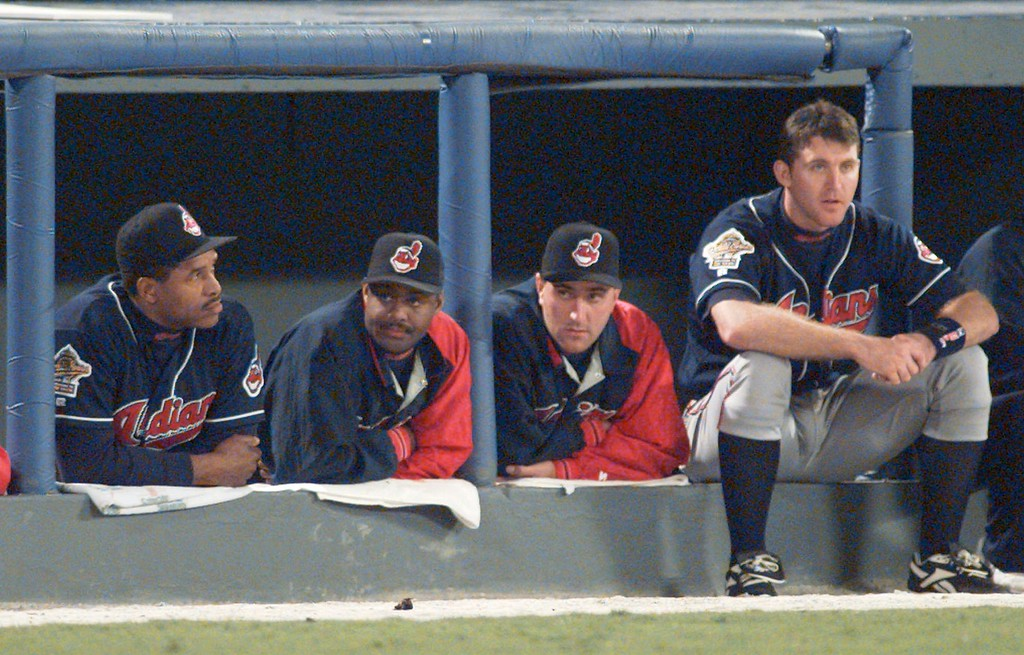 . The Cleveland Indians\' Dave Winfield, left, Ken Hill, Mark Clark and Jim Thome, right, watch from the dugout in the closing minutes of Game 2 at the World Series in Atlanta, Sunday, Oct. 22, 1995.  The Atlanta Braves beat the Indians 4-3 to to take a 2-0 lead in the best-of-seven series. (AP Photo/Eric Draper)