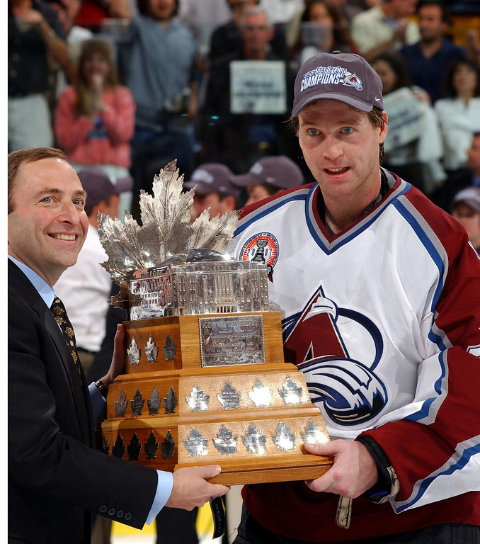 . Avalanche  goalie Patrick Roy is presented the Conn Smythe trophy by NHL commissioner Gary Bettman after defeating the Devils 3-1 in Denver for the  Stanley Cup Championship in 2001. (John Leyba/The Denver Post)
