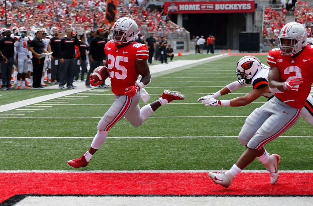 . Ohio State running back Mike Weber, left, scores a touchdown against Oregon State during the first half of an NCAA college football game Saturday, Sept. 1, 2018, in Columbus, Ohio. (AP Photo/Jay LaPrete)