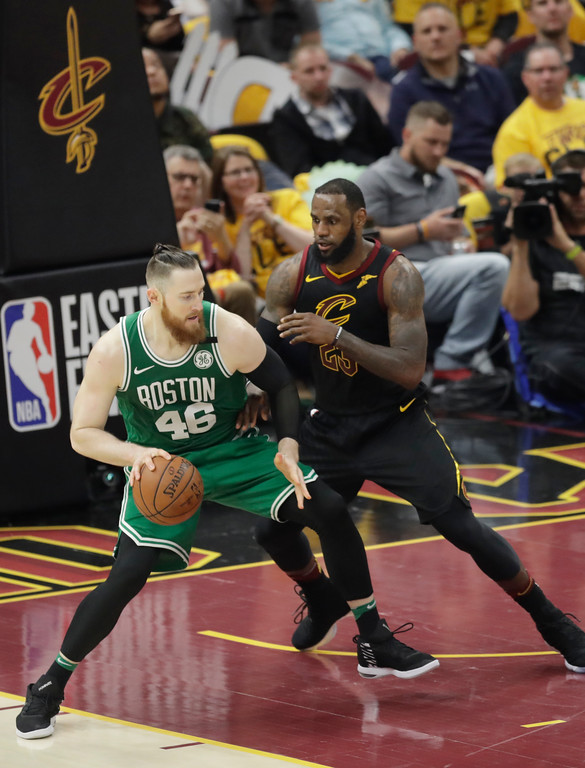 . Boston Celtics\' Aron Baynes (46), from Australia, keeps the ball from Cleveland Cavaliers\' LeBron James (23) in the second half of Game 3 of the NBA basketball Eastern Conference finals, Saturday, May 19, 2018, in Cleveland. (AP Photo/Tony Dejak)