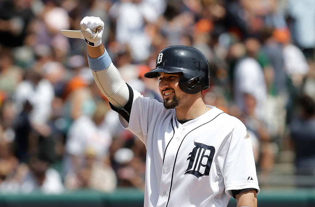 . Detroit Tigers\' Nick Castellanos acknowledges hitting a one run double against the Minnesota Twins in the sixth inning of a baseball game in Detroit, Sunday, June 15, 2014. (AP Photo/Paul Sancya)
