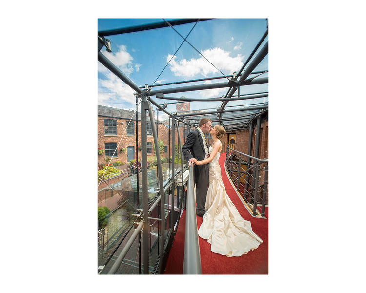 Wedding Photography of Hannah & Edward, Austin Court, Birmingham, Photograph is of the Bride & Groom kissing under the glass roof of the venue