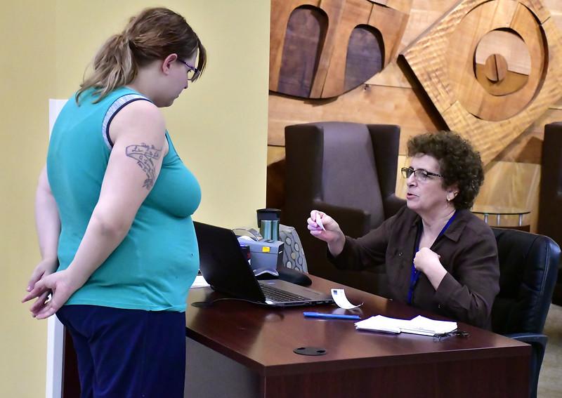 9/19/2018 Mike Orazzi | Staff Bristol Hospital's Diane Desjardins explains how the new visitors badge works to Michelle Carroll.