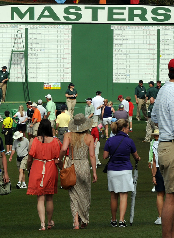 . US skier Lindsey Vonn  (C) walks near the clubhouse as she waits for Tiger Woods of the US to tee off during the first round of the 77th Masters golf tournament at Augusta National Golf Club on April 11, 2013 in Augusta, Georgia.  DON EMMERT/AFP/Getty Images