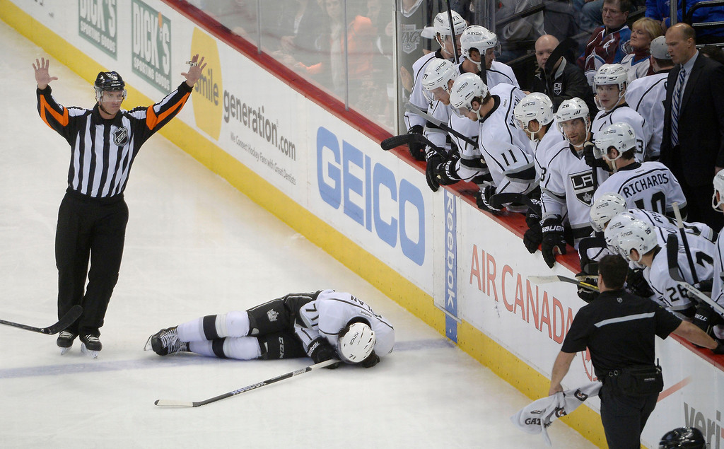. Los Angeles Kings center Jordan Nolan (71) lays o the ice after hitting the dasher boards during  the second period against the Colorado Avalanche February 27, 2014 at Pepsi Center. (Photo by John Leyba/The Denver Post)