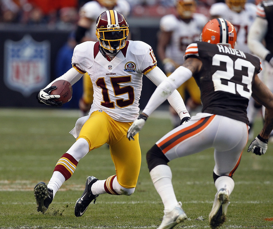 . Wide receiver Joshua Morgan #15 of the Washington Redskins runs  the ball by cornerback Joe Haden #23 of the Cleveland Browns at Cleveland Browns Stadium on December 16, 2012 in Cleveland, Ohio.  (Photo by Matt Sullivan/Getty Images)