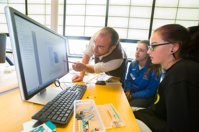 """FREE TO USE IMAGE. WIT Summer Camp. Pictured at WIT Waterford Institute of Technology at the """"Internet of Things"""" workshop is Padraig Murphy of SEMS The South East Makerspace and Rachel Walsh and Rachel Purcell. Picture: Patrick Browne  Students who will be sitting the Leaving Cert in June 2017 get to grips with the Internet of Things at Waterford Institute of Technology's HEA-funded summer camp for 5th year students which ran over four days from Tuesday, 7 June to Friday, 10 June. The range of disciplines students got to try out include: 3D Animation, Build a computer workshop, Coding, Internet of Things, Audio and Video Development, Web Development, Games Development and Virtual Reality.  Last year WIT added an Internet of Things 4-year Level 8 course to its suite of undergraduate Computing courses. See www.wit.ie/cao."""