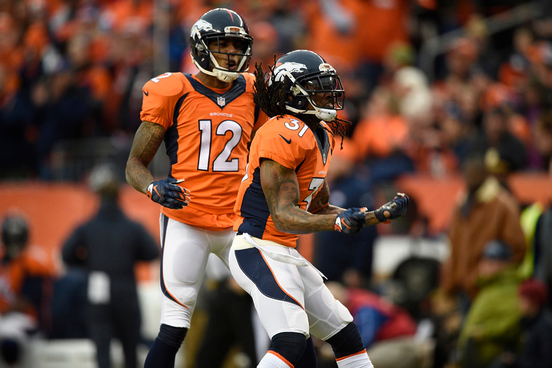 . Omar Bolden (31) of the Denver Broncos and Andre Caldwell (12) of the Denver Broncos celebrate a big hit on a punt return in the first quarter. The Denver Broncos played the Indianapolis Colts in an AFC divisional playoff game at Sports Authority Field at Mile High in Denver on January 11, 2015. (Photo by John Leyba/The Denver Post)