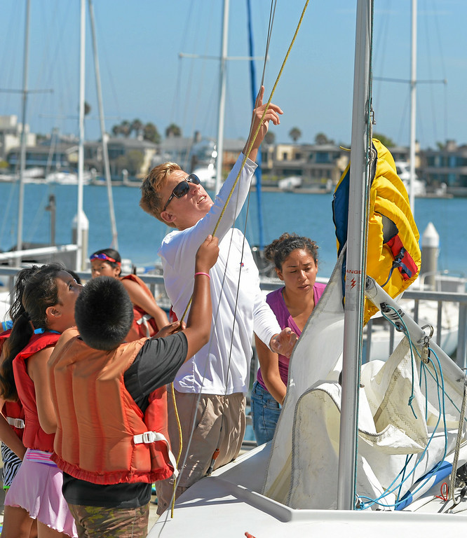 . Sailing instructor Chris Segerblom teaches a group of Huntington Beach school children from the El Viento Foundation\'s Reach program learn to sail in Long Beach, CA on Wednesday, July 30, 2014. The students, who come from a lower income neighborhood, were given the sailing lessons by staff at the U.S. Sailing Center. (Photo by Scott Varley, Daily Breeze)