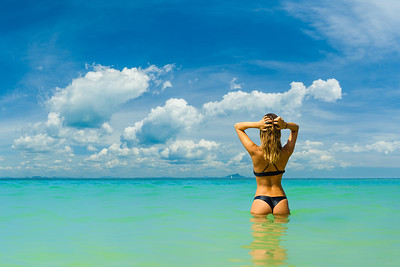 Attractive woman with perfect body standing up in sea,