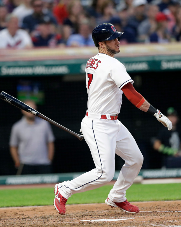 . Cleveland Indians\' Yan Gomes watches his RBI-single off Minnesota Twins starting pitcher Kyle Gibson during the sixth inning of a baseball game Friday, June 15, 2018, in Cleveland. (AP Photo/Tony Dejak)