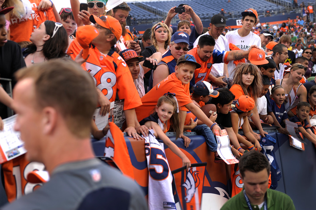 . DENVER, CO. - AUGUST 03: Denver Broncos quarterback Peyton Manning signed autographs for fans inside the stadium Saturday night. Denver Broncos fans waited inside Sports Authority Field Saturday night, August 3, 2013 hoping the weather would clear so that the team could practice.  Photo By Karl Gehring/The Denver Post