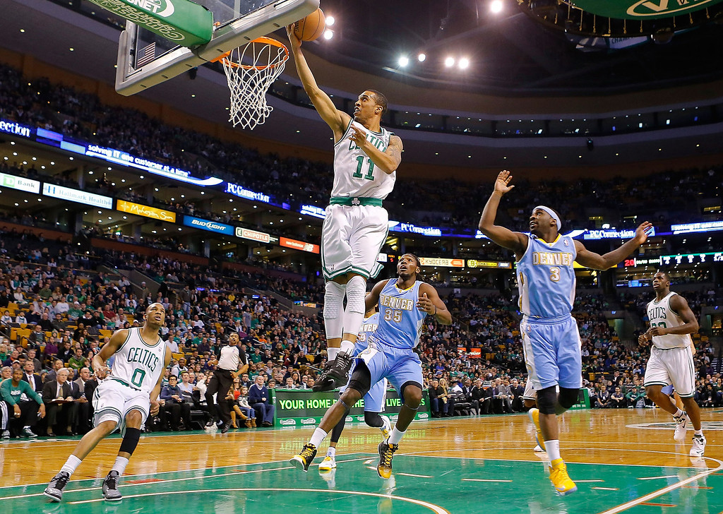 . BOSTON, MA - FEBRUARY 10: Courtney Lee #11 of the Boston Celtics goes up for a layup against the Denver Nuggets during the game on February 10, 2013 at TD Garden in Boston, Massachusetts.  (Photo by Jared Wickerham/Getty Images)