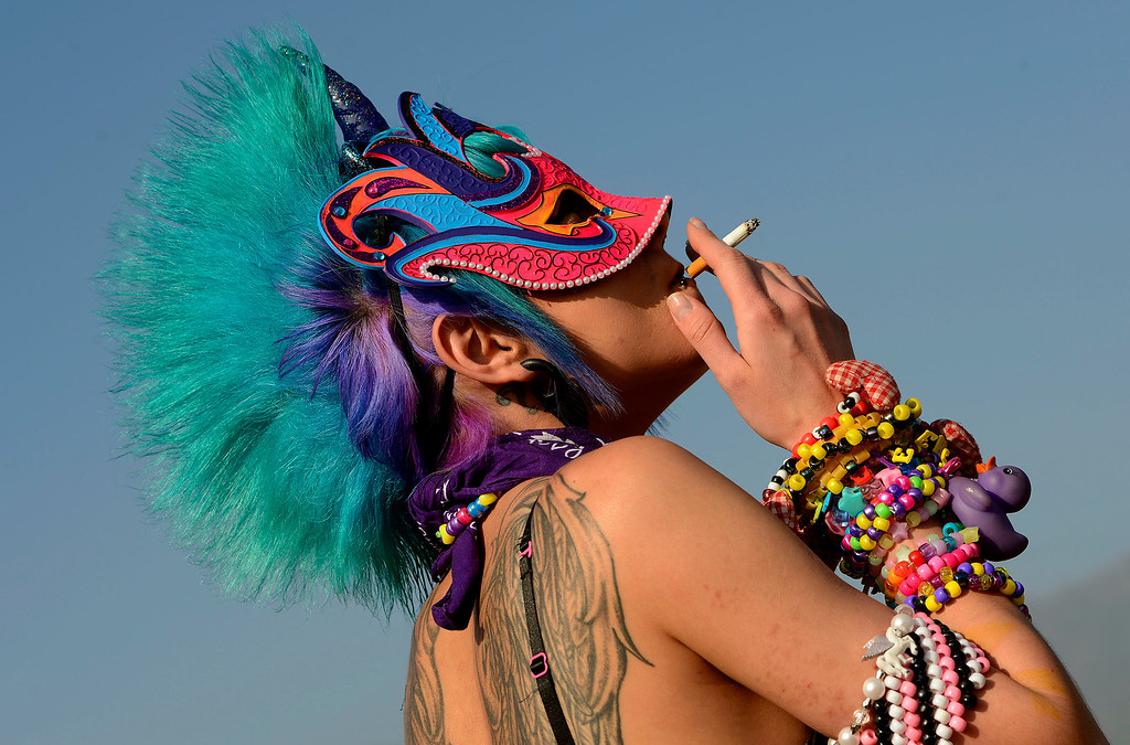 . Ani Yegiazaryan, 21, of Running Springs, dresses as a Pegacorn during Insomniac\'s Beyond Wonderland rave at San Manuel Amphitheater in San Bernardino March 16, 2013.  (Photo by Gabriel Luis Acosta/The Sun)