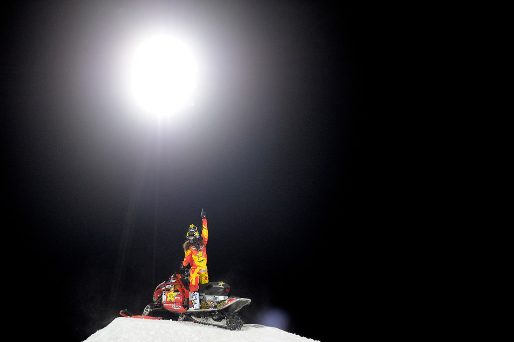 . Colten Moore celebrates his monster first run by pointing into the night\'s sky during the snowmobile freestyle final. Moore, whose brother Caleb died as a result of injuries in last year\'s event, won his second career gold medal in freestyle. X Games Aspen at Buttermilk on Thursday, January 23, 2014. (Photo by AAron Ontiveroz/The Denver Post)