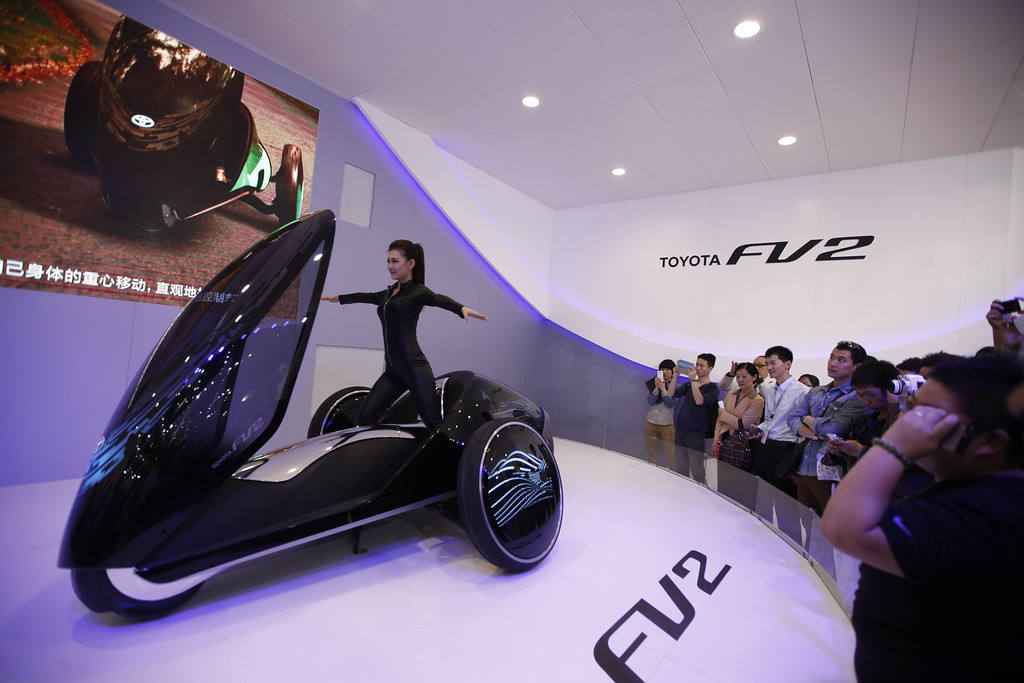". A model (C) poses on a Toyota FV2 concept car at the China International Exhibition Center new venue during the ""Auto China 2014\"" Beijing International Automotive Exhibition in Beijing on April 21, 2014.   AFP PHOTOSTR/AFP/Getty Images"