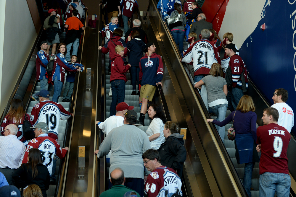 . Fans file into the Pepsi Center before the first period of action. The Colorado Avalanche hosted the Minnesota Wild at the Pepsi Center on Thursday, April 17, 2014. (Photo by Karl Gehring/The Denver Post)
