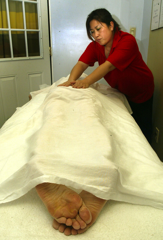 . Guo Xia Mao giving full body massage to Nancy Chan of Monterey Park at Magic Hands Spa located at 145 E. Duarte Road in Arcadia.  The city of Arcadia has placed a moratorium on all new massage therapy locations, as well as any new licenses for massage therapists. Officials suspect prostitution at many locations.  Magic Hands Spa says it is one of the legitmate businesses and supports the city\'s efforts. (SGVN/Staff Photo by Walt Mancini/SXCity)