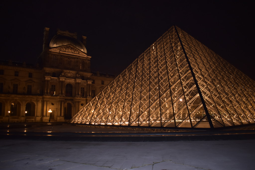 The Louvre Museum at night in Paris, France