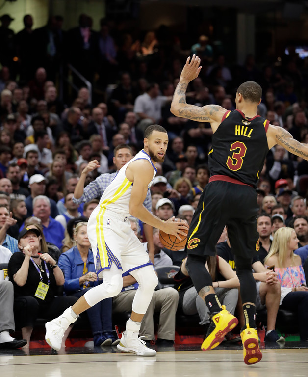 . Golden State Warriors\' Stephen Curry is defended Cleveland Cavaliers\' George Hill in the first half of Game 4 of basketball\'s NBA Finals, Friday, June 8, 2018, in Cleveland. (AP Photo/Tony Dejak)