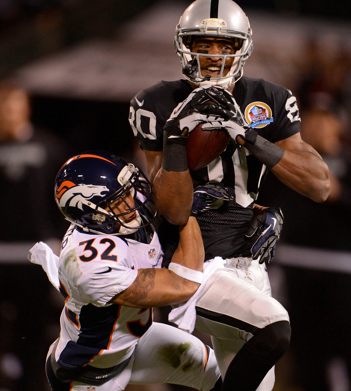 . Oakland Raiders wide receiver Rod Streater (80) catches a deep pass on Denver Broncos free safety Rahim Moore Tony Carter (32) in the first quarter Thursday, December 6, 2012 during Thursday Night Football at O.c Coliseum in Oakland  John Leyba, The Denver Post