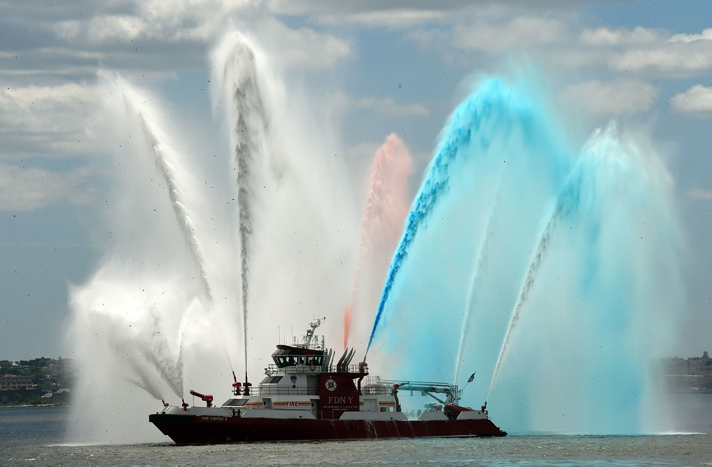 . The New York City fireboat sprays colored water into the New York Harbor June 6, 2014 in New York. Thousands gathered on the Liberty Island to participate in ceremonies commemorating the 70th anniversary of D-Day. AFP PHOTO/Don EMMERT/AFP/Getty Images