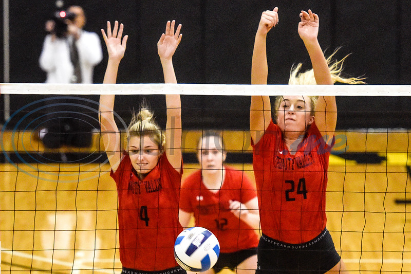 Trinity Valley Community College's Erica Airheart (4) and Lauren Castles (24) jump to block the ball during a college volleyball game at Tyler Junior College in Tyler, Texas, on Wednesday, Sept. 19, 2018. (Chelsea Purgahn/Tyler Morning Telegraph)