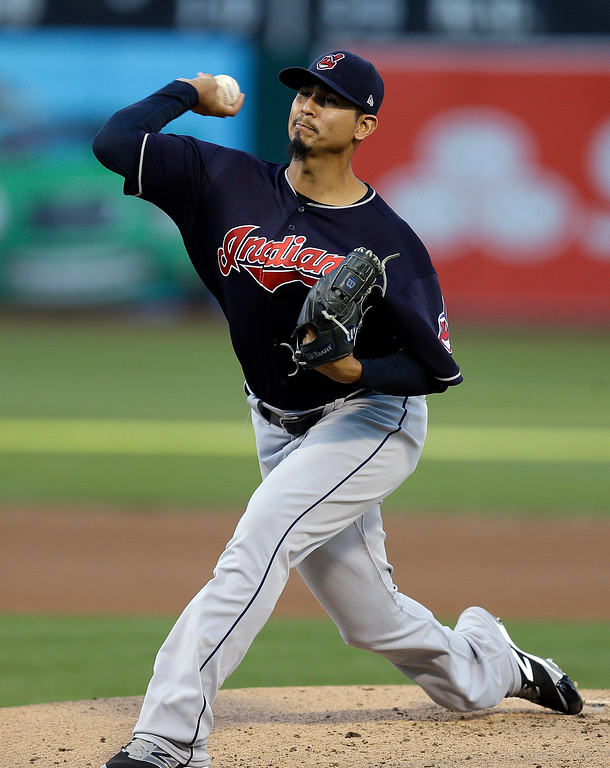 . Cleveland Indians pitcher Carlos Carrasco works against the Oakland Athletics during the first inning of a baseball game Friday, July 14, 2017, in Oakland, Calif. (AP Photo/Ben Margot)