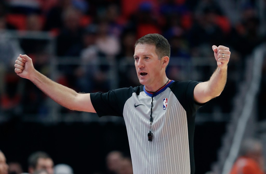 . Referee Brent Barnaky signals during the second half of an NBA basketball game between the Detroit Pistons and the Cleveland Cavaliers, Monday, Nov. 20, 2017, in Detroit. (AP Photo/Carlos Osorio)