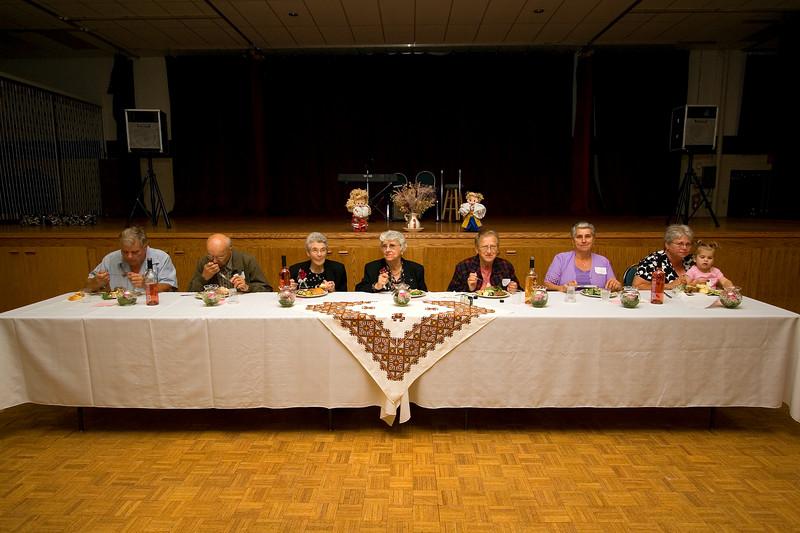 Head table - Mike Borhen, Tom Rosychuk, Mary Rosychuk, Annie Prusko, Eleanor Sorokan, Patricia Gogowich and Jackie Oranchuk with Emmalie Shurtz.
