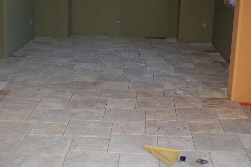 The dining room is not only painted, but the tile is set.