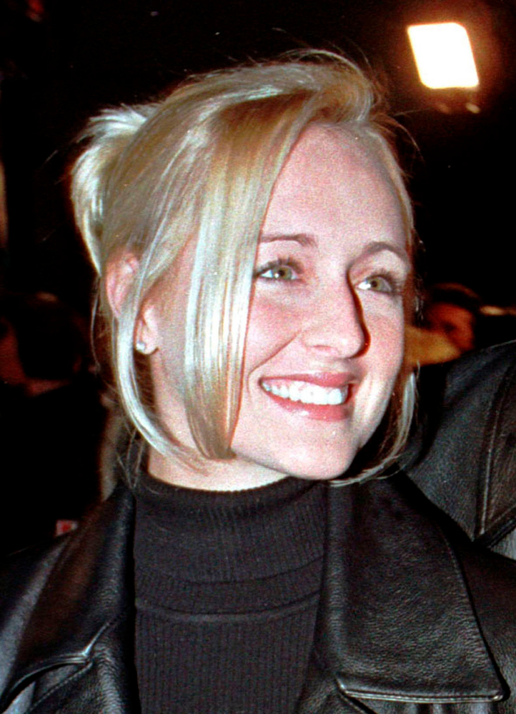 ". Country music singer Mindy McCready attends the premiere of the horror film ""Scream 2\"" at Mann\'s Chinese Theatre in Hollywood in this December 10, 1997 file photograph. McCready has died at 37 from an apparent self-inflicted gun shot wound ,Arkansas sheriff reported on February 17, 2013. REUTERS/Fred Prouser/Files"