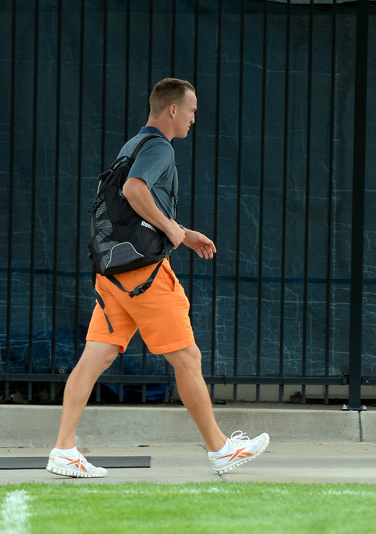 . Denver Broncos quarterback Peyton Manning walks to the entrance as he reports to camp July 24, 2013 at Dove Valley. The players had physicals at the teams headquarters. (Photo By John Leyba/The Denver Post)