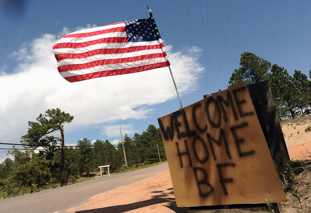 . Signs welcome residents of Black Forest home along Burgess Road in Black Forest, CO on June 18, 2013.   Residents of Black Forest were finally allowed back into their burned homes for the first time since the fire devoured thousands of acres inside the Black Forest taking with it 502 homes and two lives.  Photo by Helen H. Richardson/The Denver Post)