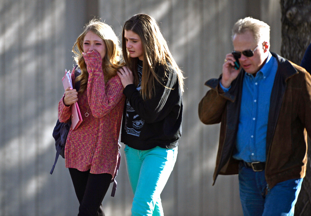 . CENTENNIAL, CO - DECEMBER 13: Students and parents leave Arapahoe High School after a gunman opened fire at the school, December 13, 2013. One student was critically wounded. (Photo by RJ Sangosti/The Denver Post)