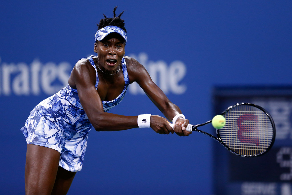 . NEW YORK, NY - AUGUST 27:  Venus Williams of the United States returns a shot against Timea Bacsinszky of Switzerland during their women\'s singles secound round match on Day Three of the 2014 US Open at the USTA Billie Jean King National Tennis Center on August 27, 2014  in the Flushing neighborhood of the Queens borough of New York City.  (Photo by Julian Finney/Getty Images)