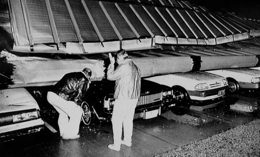 . Mr. and Mrs. Robert Carter inspect damage to their car after part of the roof of Days Inn Motel fell on it at Fayetteville in North Carolina on Sept. 22, 1989. The couple drove to the local motel to escape the storm in their home town of calabash, NC. Heavy winds from the edge of Hurricane Hugo damaged the building. (AP Photo)