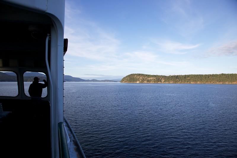 Silhouette of man on ferry. San Juan Islands, Washington.