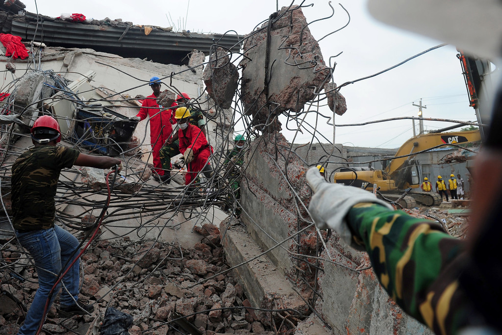 . Bangladeshi rescuers work as Bangladeshi Army personnel continue the second phase of the rescue operation using heavy equipment after an eight-story building collapsed in Savar, on the outskirts of Dhaka, on April 30, 2013. AFP PHOTO/ MUNIR UZ ZAMAN/AFP/Getty Images