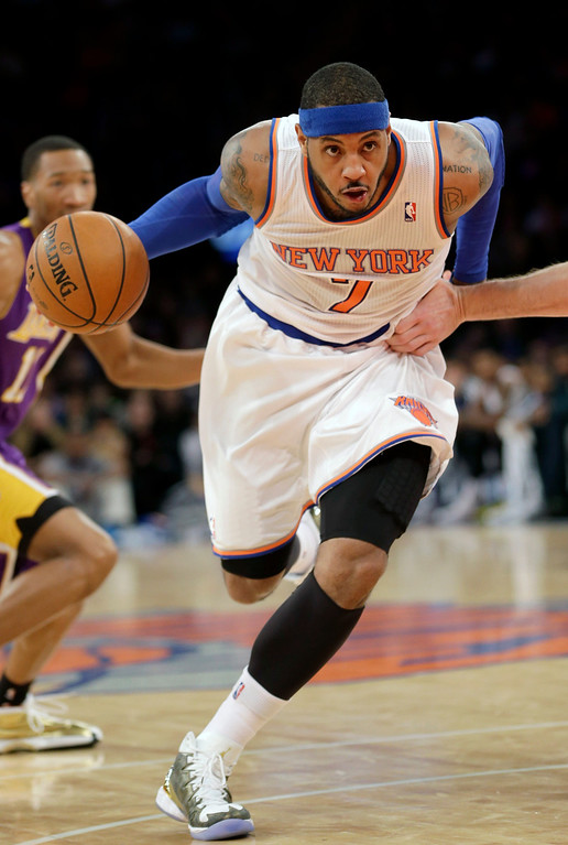 . New York Knicks\' Carmelo Anthony charges the basket during the second half of an NBA basketball game against the Los Angeles Lakers at Madison Square Garden, Sunday, Jan. 26, 2014, in New York. The Knicks won 110-103. (AP Photo/Seth Wenig)
