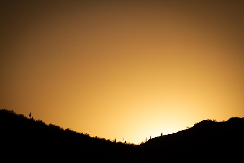 The Sun Setting Behind a Mountain