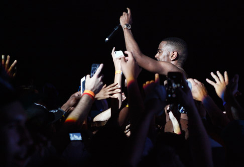 Description of . Big Sean interacts with fans at DTE Energy Music Theatre on Saturday, Aug. 31, 2013. Photo by Ken Settle